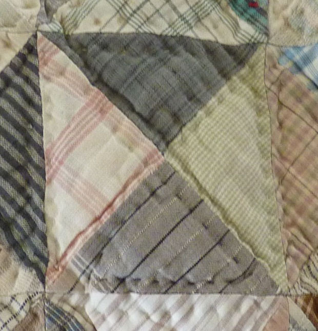 detail showing dark quilting threads