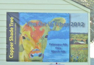 The Art in Fiber billboard