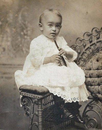 baby on rattan chair