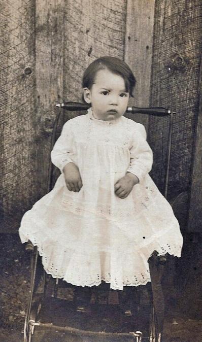 baby in eyelet dress