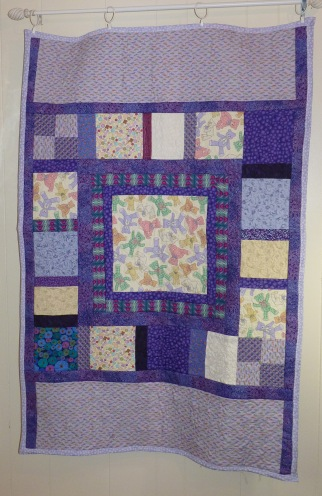 purple crib quilt
