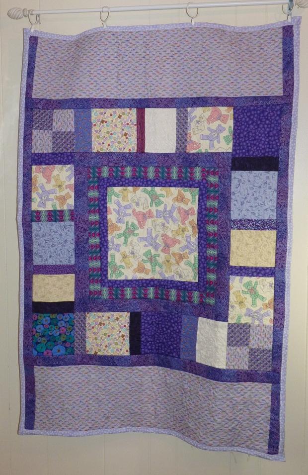 purple crib quilt