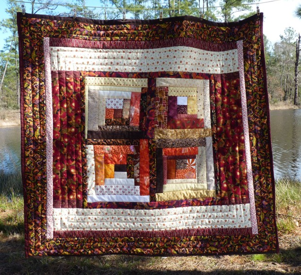red and orange lap quilt