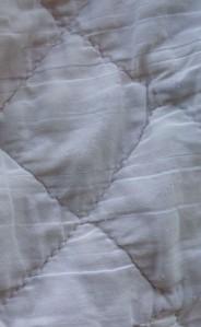hand stitches on 1980 quilt