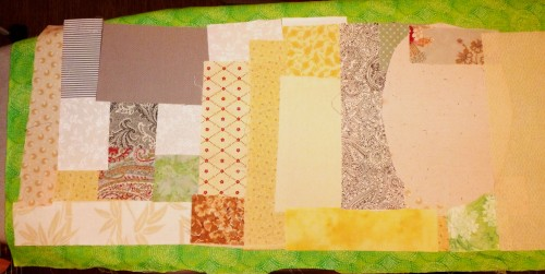 Scraps fused to a background fabric.