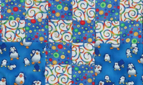I love this penguin fabric, but its color palette is so limited, I had a hard time finding other prints that would blend with it.