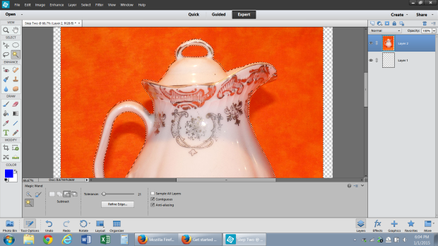 The magic wand tool selects the orange background and separates it from the white pitcher.