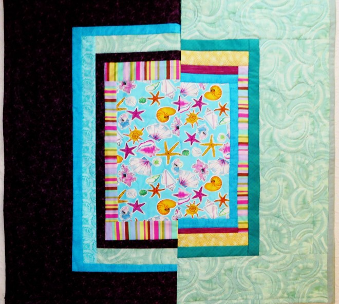 Two quilts, folded in half, to compare the fabric combinations.