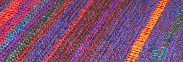 Detail showing the red cotton in the picks between the silk ribbons.