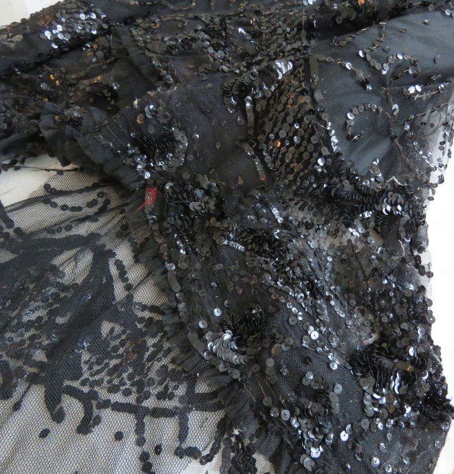 Detail of the layers of cloth and embellishment at the hemline.
