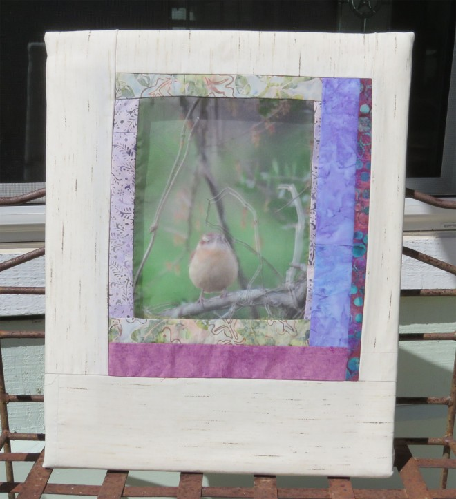 The same image is used twice - a regular print inside the shallow box, and a sheer print suspended above.