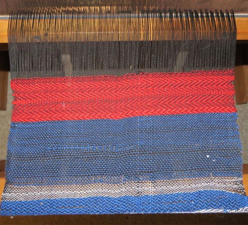 The red twill is where the 7-year-old started weaving.