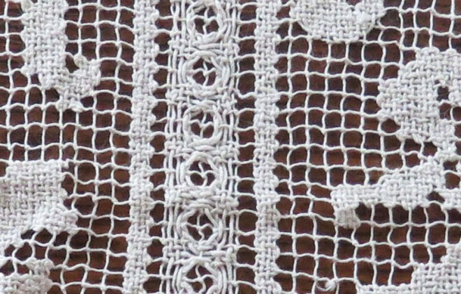 Detail of #1 - a knotted netting, with areas filled in with needle and thread.