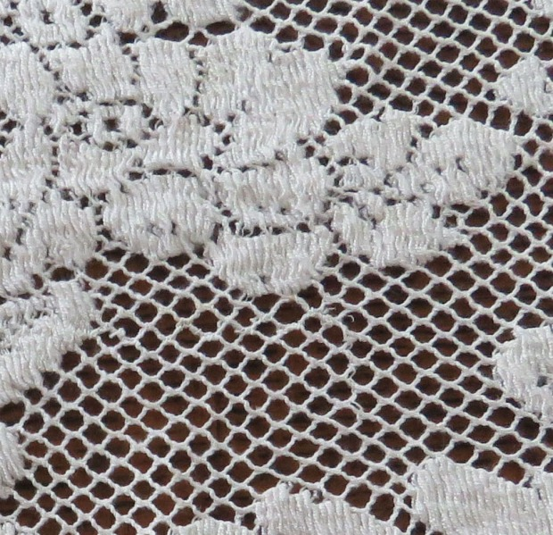 This Quaker Lace tablecloth shows still a different construction technique.  This is machine-made lace.