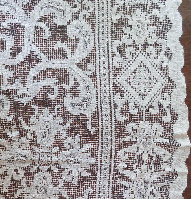 Lacy white tablecloth #1 -- a combination of biomorphic and geometric shapes.