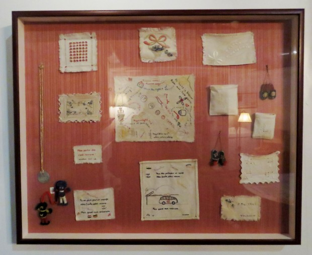 Embroideries done in secret by women prisoners in WWII, seen at the National Museum of the Mighty Eighth Air Force.