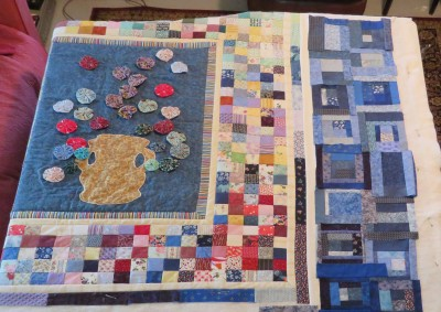 Trying the blue log cabin squares with the center.