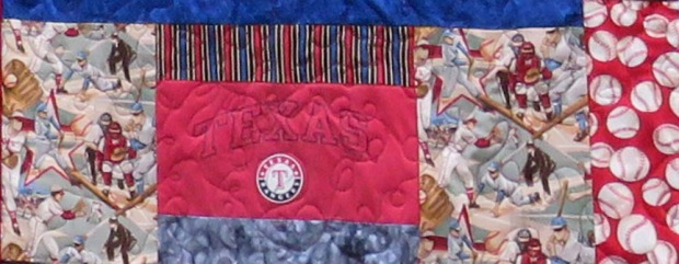 This old-fashioned looking baseball fabric worked wonders to tie the quilt together.
