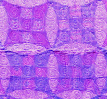 The back, showing the perfect spacing of the machine-stitched spirals. I increased the contrast, the back is a lighter purple.
