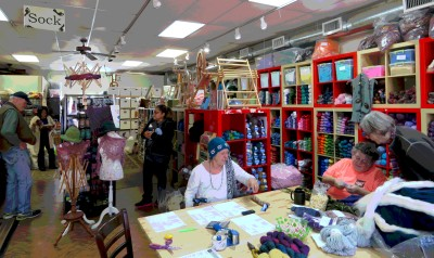 The quintessential yarn shop -- teaching, browsing, reading, and chatting going on in one bright colorful space.