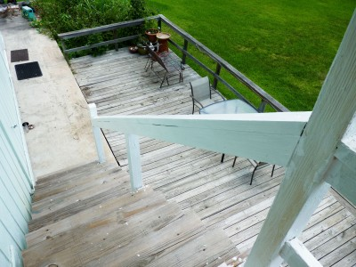 Old, sad, crumbling deck boards.