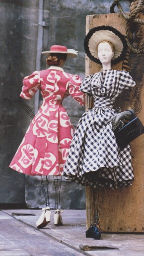 Left, Doll 81 - coat and dress ensemble in pink and white printed linen, designed by Georgette Renal.  Right, Doll 74 - dress in navy and white checked twill (synthetic), designed by Molyneux.  Photograph by David Seidner.