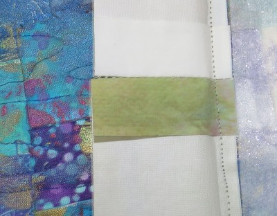 "The back of the ""fused fiber"" edging, showing that it is just printed on cloth."