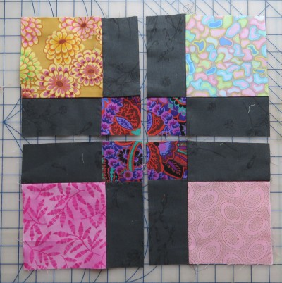 Step 1: sew a 9 patch block. Step 2: Cut it in half both horizontally and vertically.