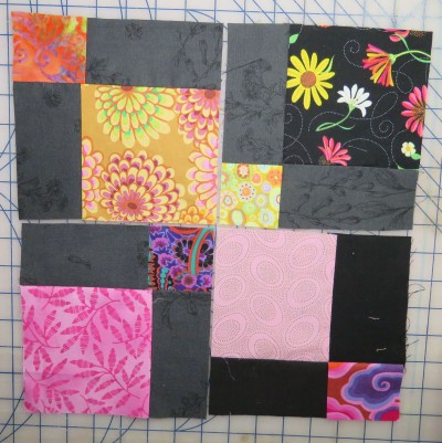 Or even better, if you ask me: swap the cut pieces from various 9-patches, so none of the little squares are the same in the reconfigured block.