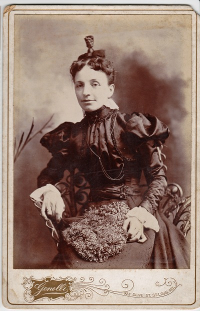 I love this confident-looking woman. Her topknot hairdo says 1890s. What is that on her lap?!! It looks like a bag made from individual silk flowers.