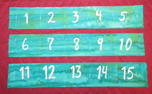The number strips before being attached to the calendar.