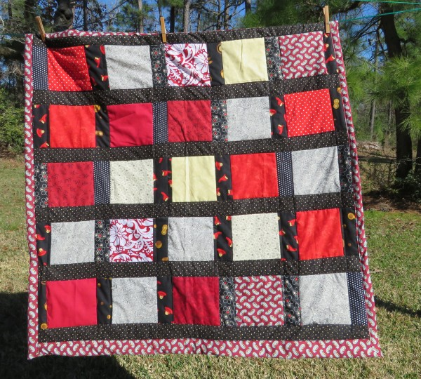Black and White and Red All Over lap quilt.