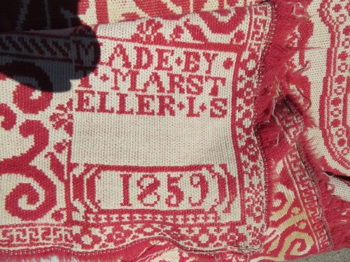 "woven label - ""made by T. Marsteller, L. S. 1859"""