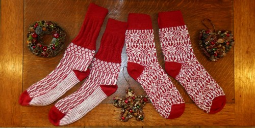 Red and white patterned wool socks, made in Germany, and Christmas ornaments made from mini pine cones and seeds.