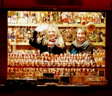 Two ladies selling wooden ornaments at Dusseldorf Christmas market.