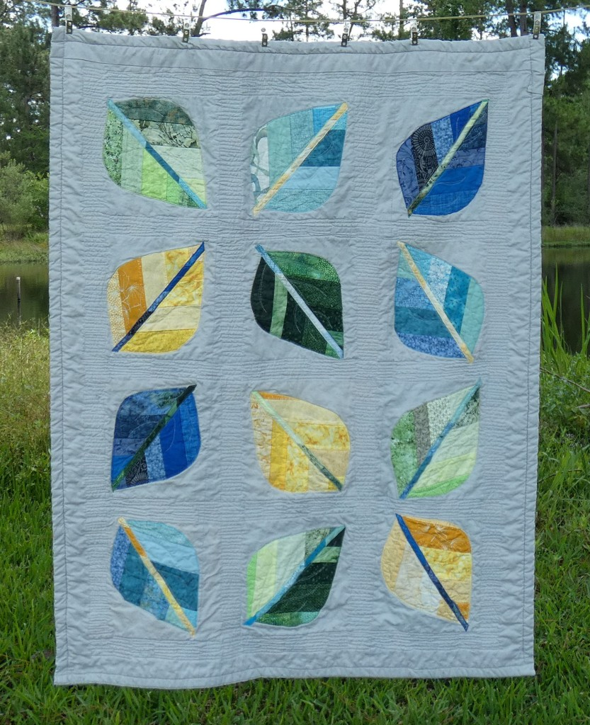 baby quilt with leaf shapes