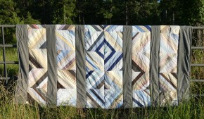 string quilt on fence