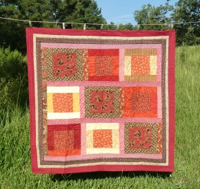 lap quilt in reds and browns