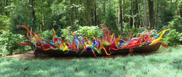 Dale Chihuly's Fiori Boat, a boat in the forest, filled with glass forms