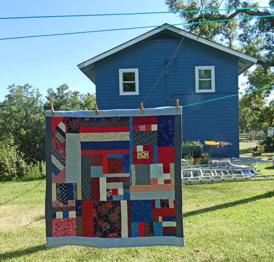 scrap quilt and blue house