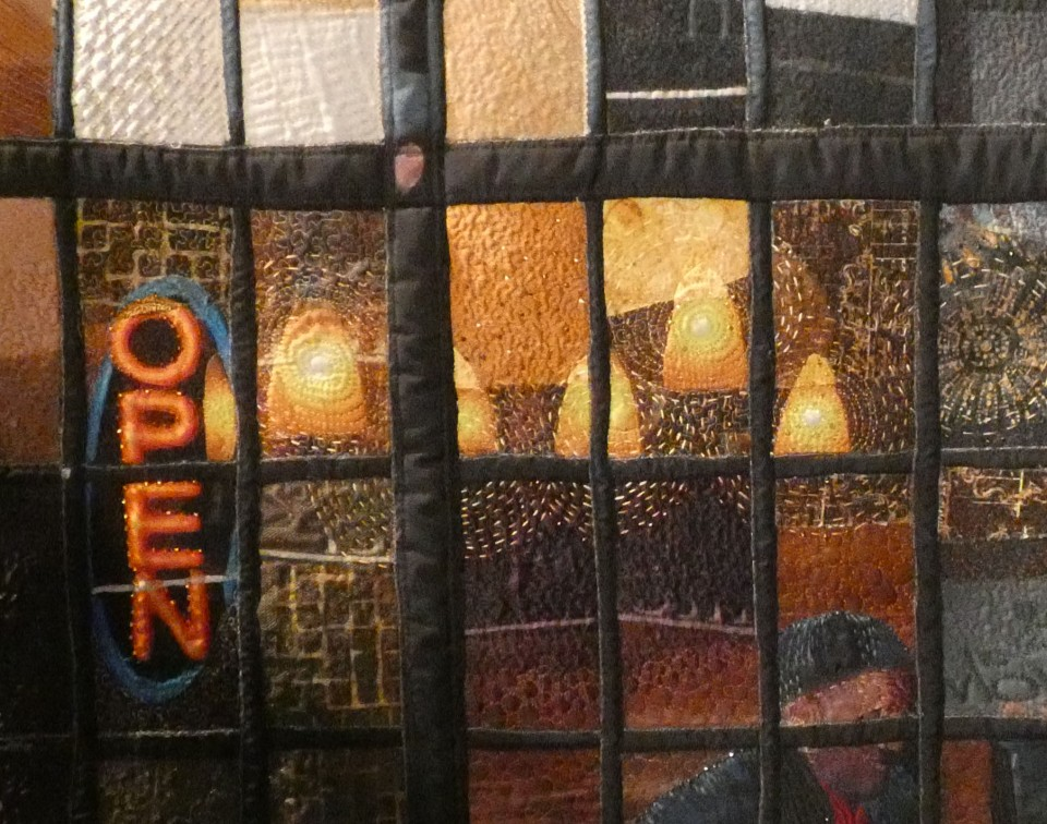 detail of quilt showing urban glass walls
