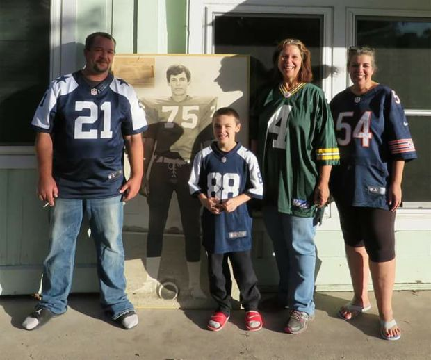 family in football jerseys