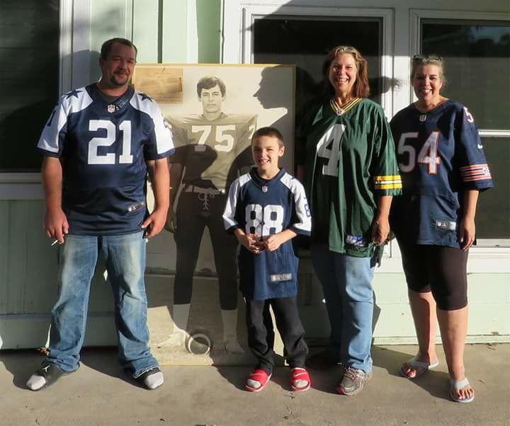 family in football jerseys