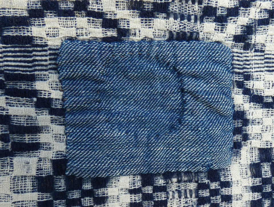 handwoven patch on handwoven coverlet