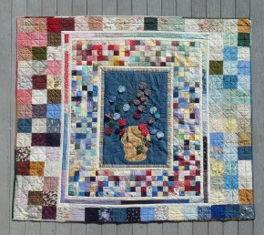 quilt with yo-yos, small squares, large squares