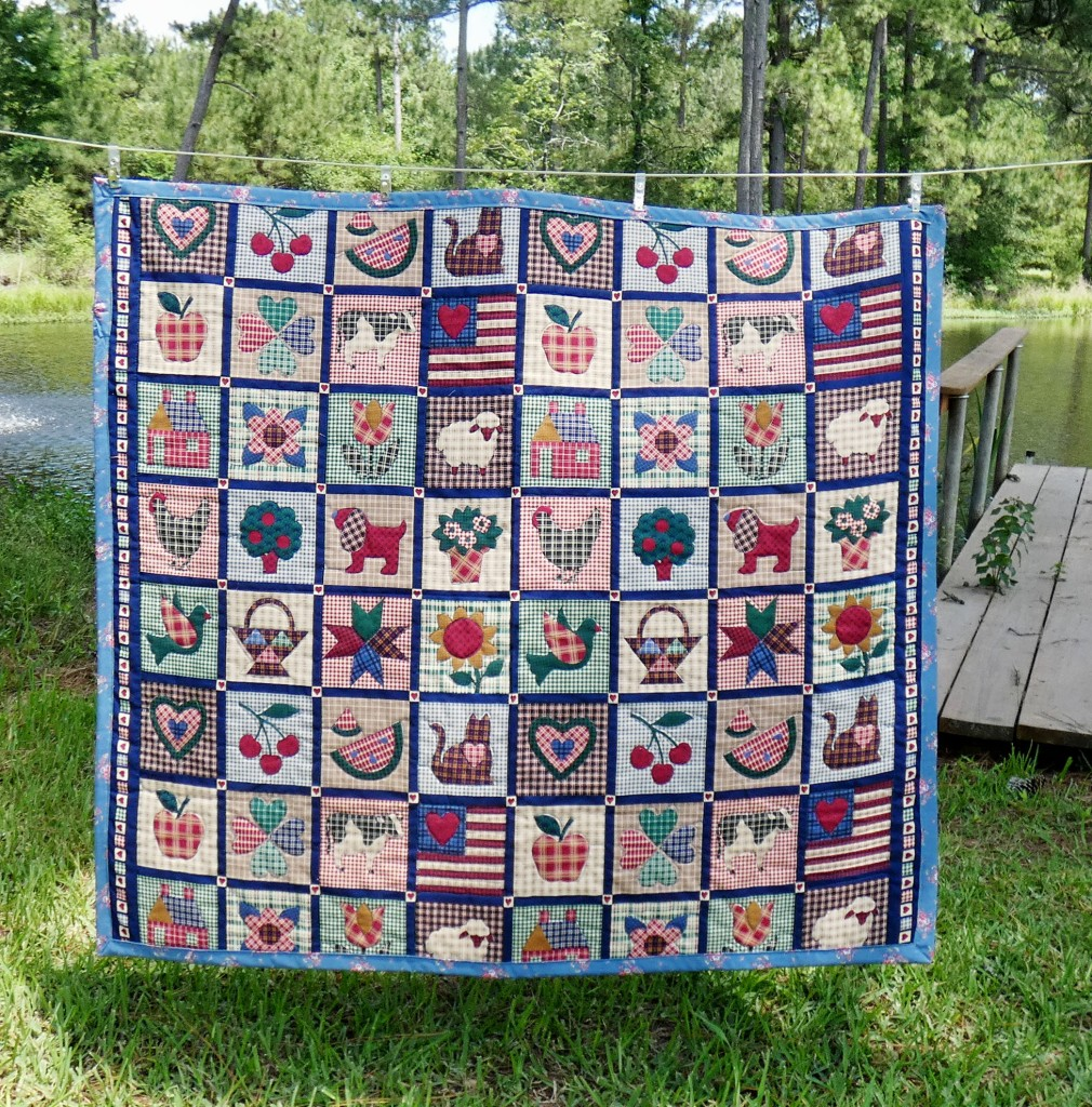 lap quilt made from fabric printed to look like intricate applique
