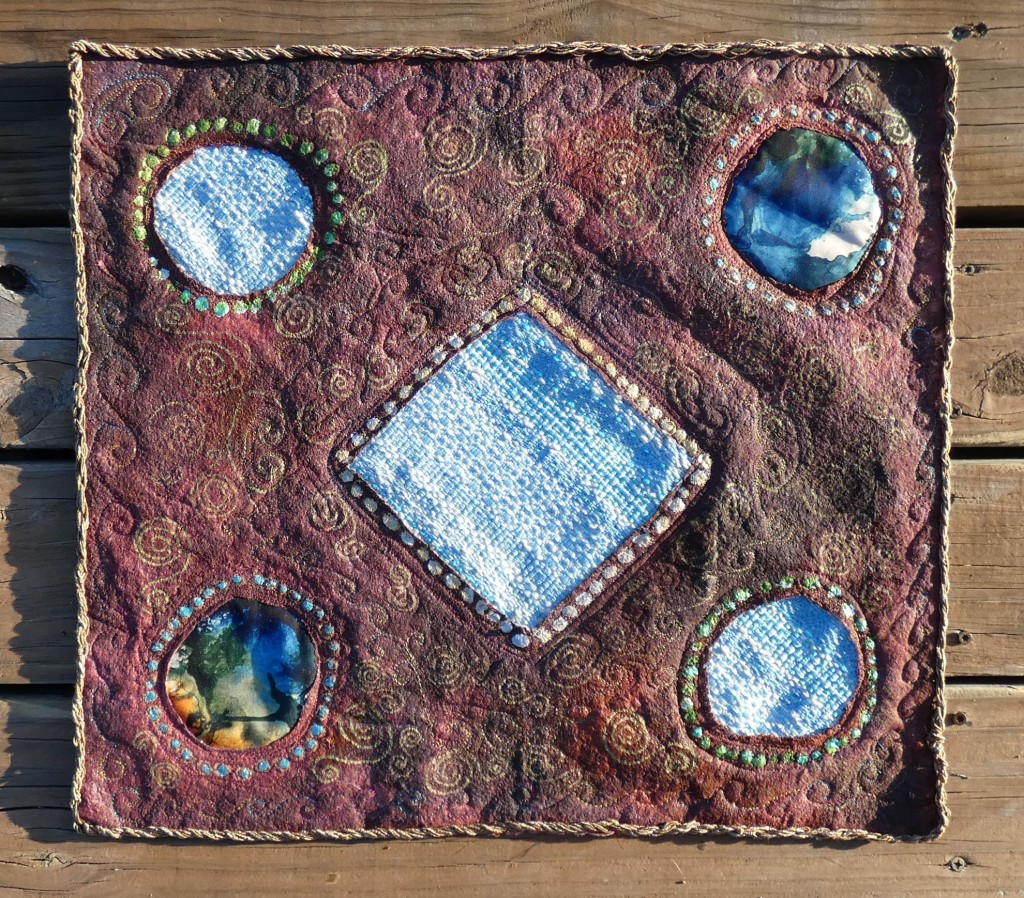 small art quilt with painted batting, handwoven fabric elements
