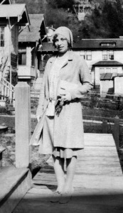Woman in suit with handbag and cap, 1930s
