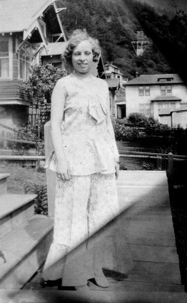 woman in flouncy summer outfit, 1930s