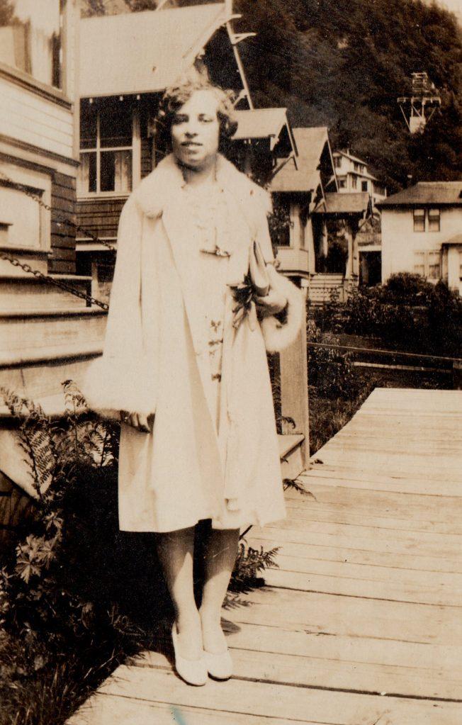 woman in pale coat with fur trim, Alaska, 1930s